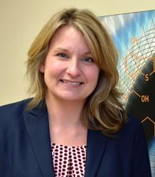 A professional headshot of Dr. Angela Roberts
