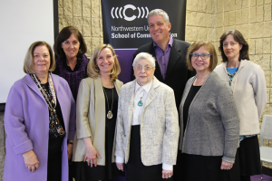 Amy Jordan, Dean O'Keefe, and five others pose for a picture at the Van Zelst Lecture in Communciation