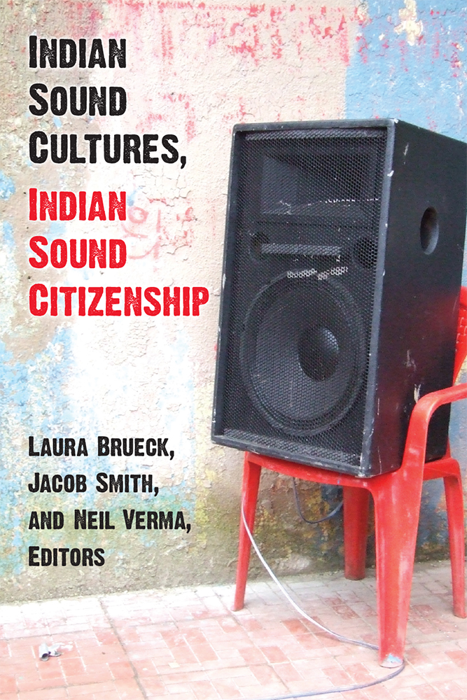 "The cover to ""Indian Sound Cultures, Indian Sound Citizenship"" - which includes a used sound speaker sitting on a plastic red chair, in front of a stucco wall with pastel colors"