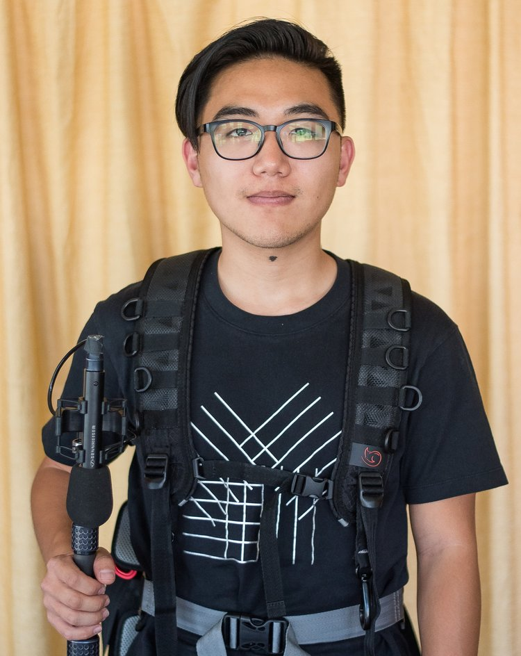 Shaun Yee holding a boom mic